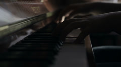 Girl playing the piano Stock Footage
