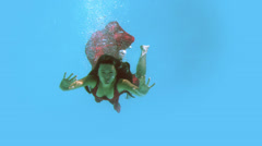 Brunette in evening gown swimming in pool Stock Footage