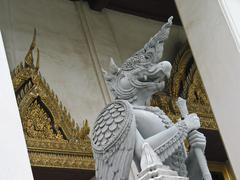 Mythical Garuda guards the entrance to temple in Asia - stock photo