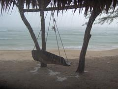 Wooden swing in the rain with sea and beach in Asia Stock Photos