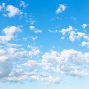 Many little fluffy clouds in blue sky Stock Photos