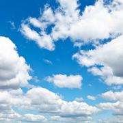 Woolpack clouds in blue sky Stock Photos