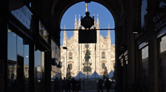 Stock Video Footage of Establishing shot. Italy, Milan, Duomo, view from arch of neighbour building.