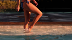 Woman kicking and splashing in the pool - stock footage