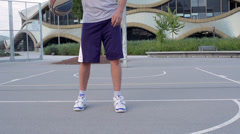 Slow-Mo: Professional Basketball Player Skillfully Dribbling The Basketball Betw Stock Footage