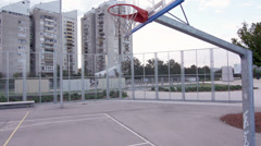 Slow-Mo: Basketball Player Performing A Slam Dunk - stock footage
