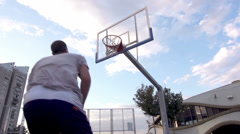 Slow-Mo: Professional Basketball Player Scores A Basket Performing Alley-Oop Stock Footage