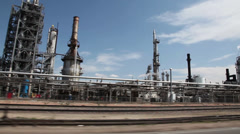 Drive through oil refinery Stock Footage
