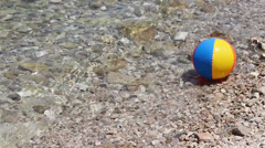 A colorful ball floating with the tides Stock Footage