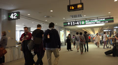 Walking through Narita airport near duty free shop - stock footage