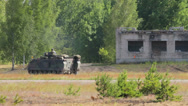 Stock Video Footage of Soldiers drive backwards in an armoured vehicle in the field