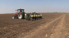 Sowing ang fertilizing with tractor and seeder Stock Footage