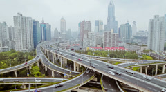 Busy traffic over overpass in modern city , Shanghai, China Stock Footage