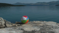 A water ball on a rock near a sea Stock Footage