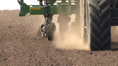 Tractor and seeder working in the field Stock Footage