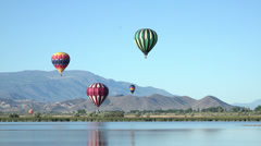 Hot air balloon flight over mountain valley lake HD 057 Stock Footage