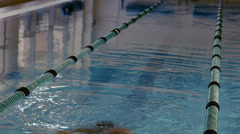 Fit swimmer jumping up and cheering in the pool Stock Footage