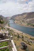 ataturk dam on euphrates river - stock photo