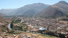 Peru Sacred Valley town along river and steep slopes - stock footage