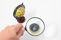 Vintage tools globe compass and loupe Stock Photos