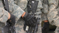 US soldiers hold weapons, camouflage, close-up Stock Footage