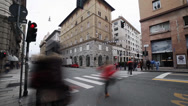 Stock Video Footage of rainy day in genova, italy. people crossing via xx settembre.blurred motion.