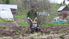 Farmer plowing Stock Footage