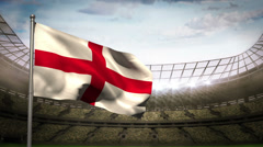 England national flag waving on stadium arena Stock Footage