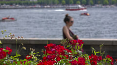 Italy, lake Como and town Como landscape. Flowers on embankment. Stock Footage