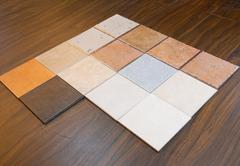 some ceramic tiles on floorboard - stock photo