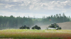 Armoured fighting vehicles and Danish tank with soldiers in the field Stock Footage