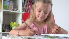 Ultra HD 4K Little Girl Learning, Studying Drawing a Book, Child Writing, Office Stock Footage