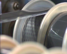 Devoloping exposed motion picture film in film laboratory - close up Stock Footage