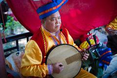 Chinese mid adult man playing musical instrument Stock Photos
