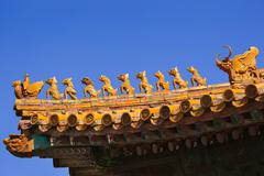 sculptures on the palace roof in forbidden city - stock photo