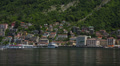 Establishing shot. Italy, lake Como, town Como view with boats, and mountains. Footage