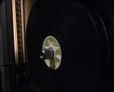 Film reel rotates in film lab during development process Stock Footage