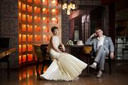 Bride and groom in  interior Stock Photos