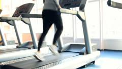 People at the gym exercising - stock footage