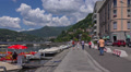Italy, lake Como and town of Como view with boats, yachts and mountains. Footage