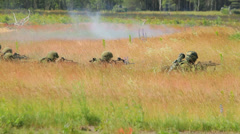 Soldiers shoot in the field near the forest, camouflage, smoke Stock Footage