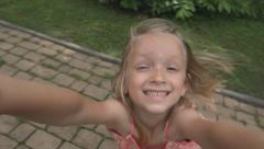 Portrait Spinning Little Girl Playing, Smiling in Camera, Children at Playground - stock footage