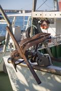 Fishing boats in harbor - rusty anchor Stock Photos