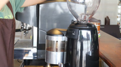 BaristaPouredCoffeeBeansInToGrinderStockVideo HD Stock Footage