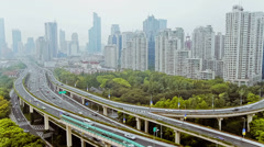 Busy traffic over overpass in modern city , Shanghai, China - stock footage
