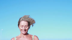 Fit senior woman pausing on her run - stock footage