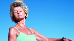 Fit senior woman pausing on her run to check her heartrate - stock footage
