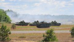 Armoured fighting vehicles prepare for attack in the field  Stock Footage