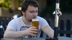 Man Sips Beer In Pub Stock Footage