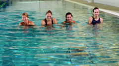 Fit women doing aqua aerobics Stock Footage